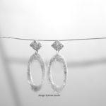 oorbellen wit goud met diamant krasjes